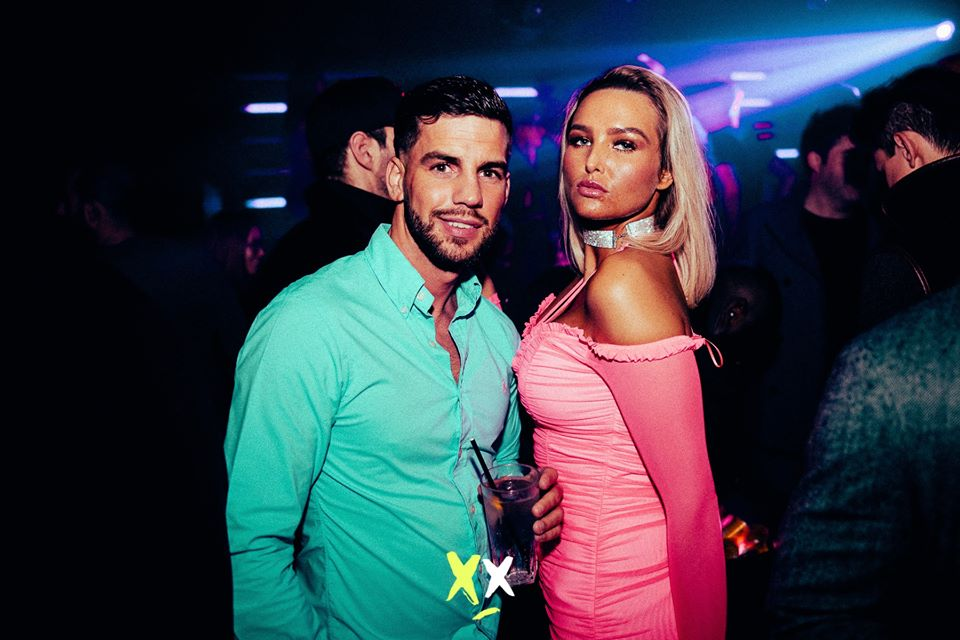 couple enjoying table booking at luxx club
